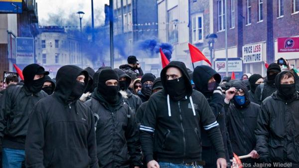 Unite Against Fascism UAF combating the Far Right groups at Anti-Immigration anti-Refugee rally organised by the National Front in Dover Kent January 30 2016
