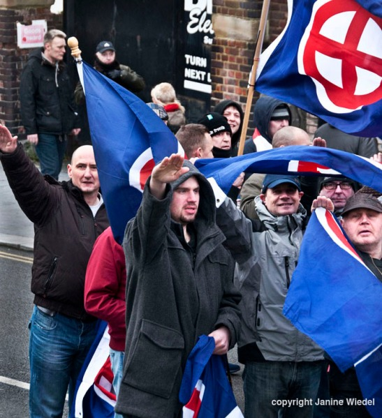 "Waving Nazi /neo-Nazi 'sunwheel"" flags,right wing extremist groups at an Anti-Immigration anti-refugee Rally organized by the National Front Dover Kent Jan 30th 2016"
