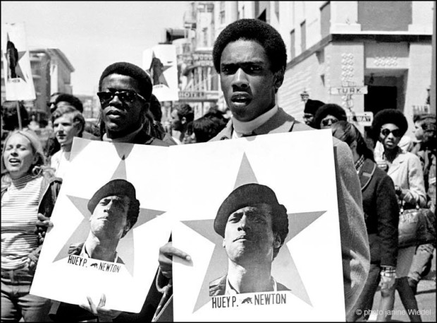Black power march in Oakland California in the 1960's protesting the imprisonment of Huey Newton.